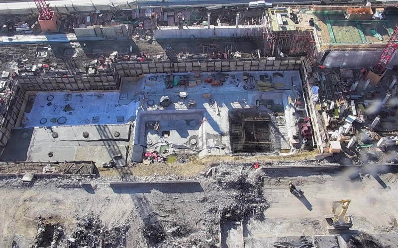 Elevator pits are formed and structural columns are constructed.